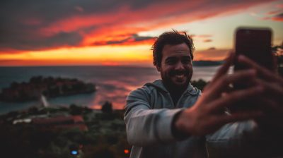Young man talking a selfie by the sea