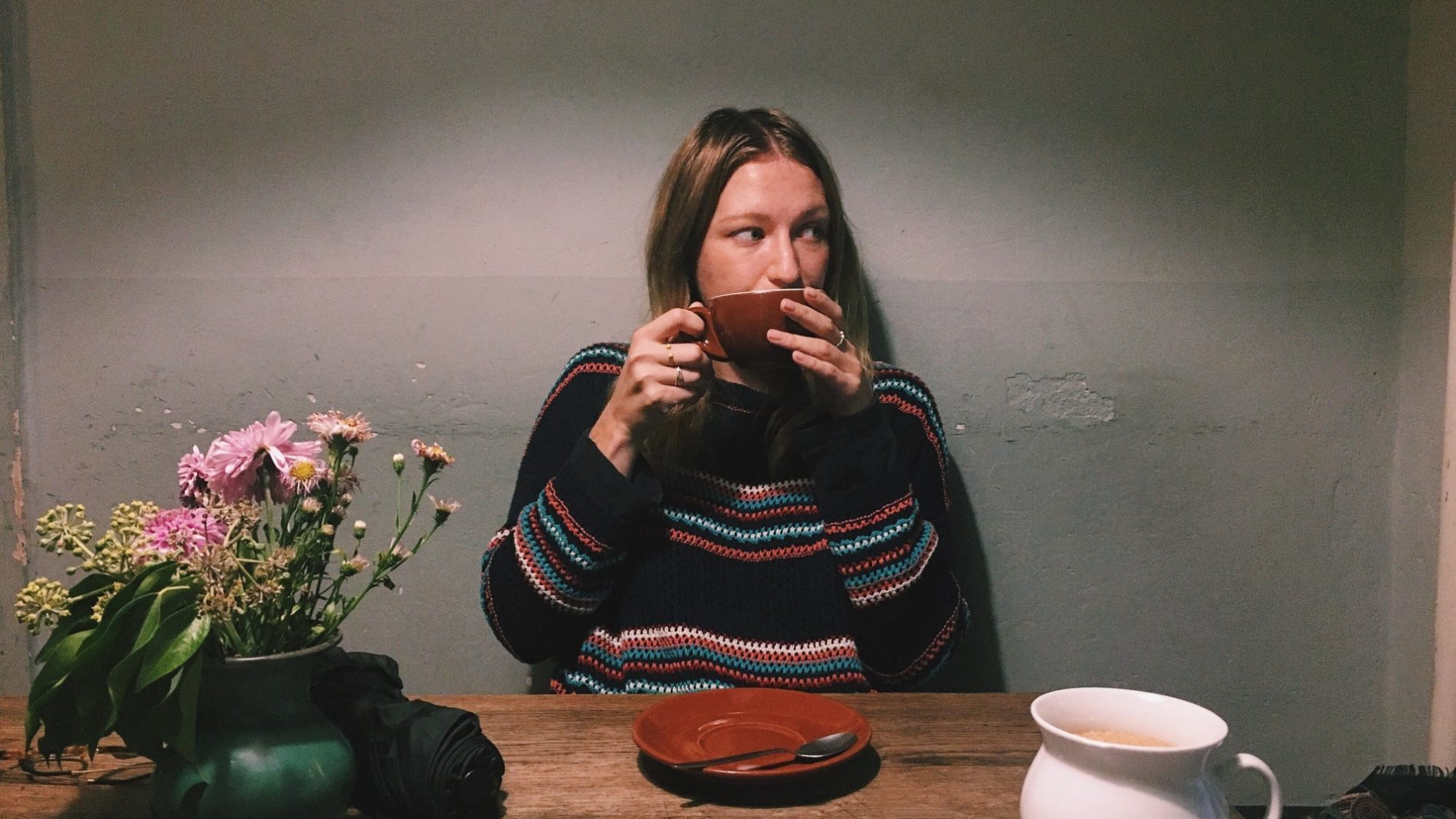Young-person-drinking-tea-at-home