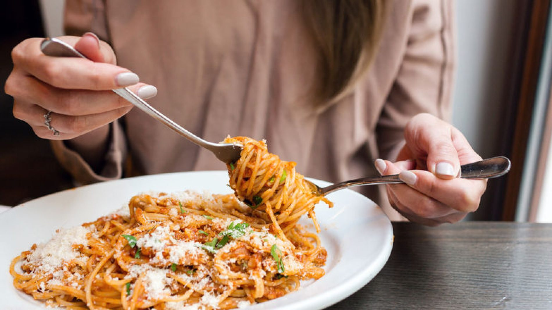 Young-person-eating-a-bowl-of-pasta