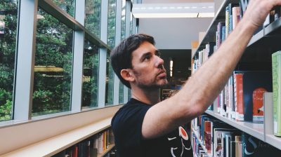 Young-person-in-college-library-to-study