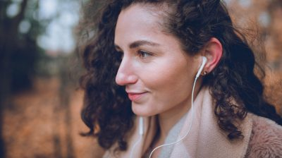 Young person practising self-care and listening to music