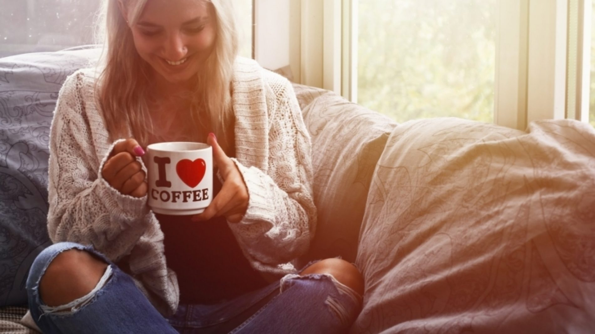 Young-person-on-couch-with-coffee-CB0CZw