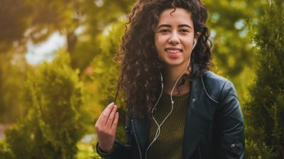 Young person outside listening to music