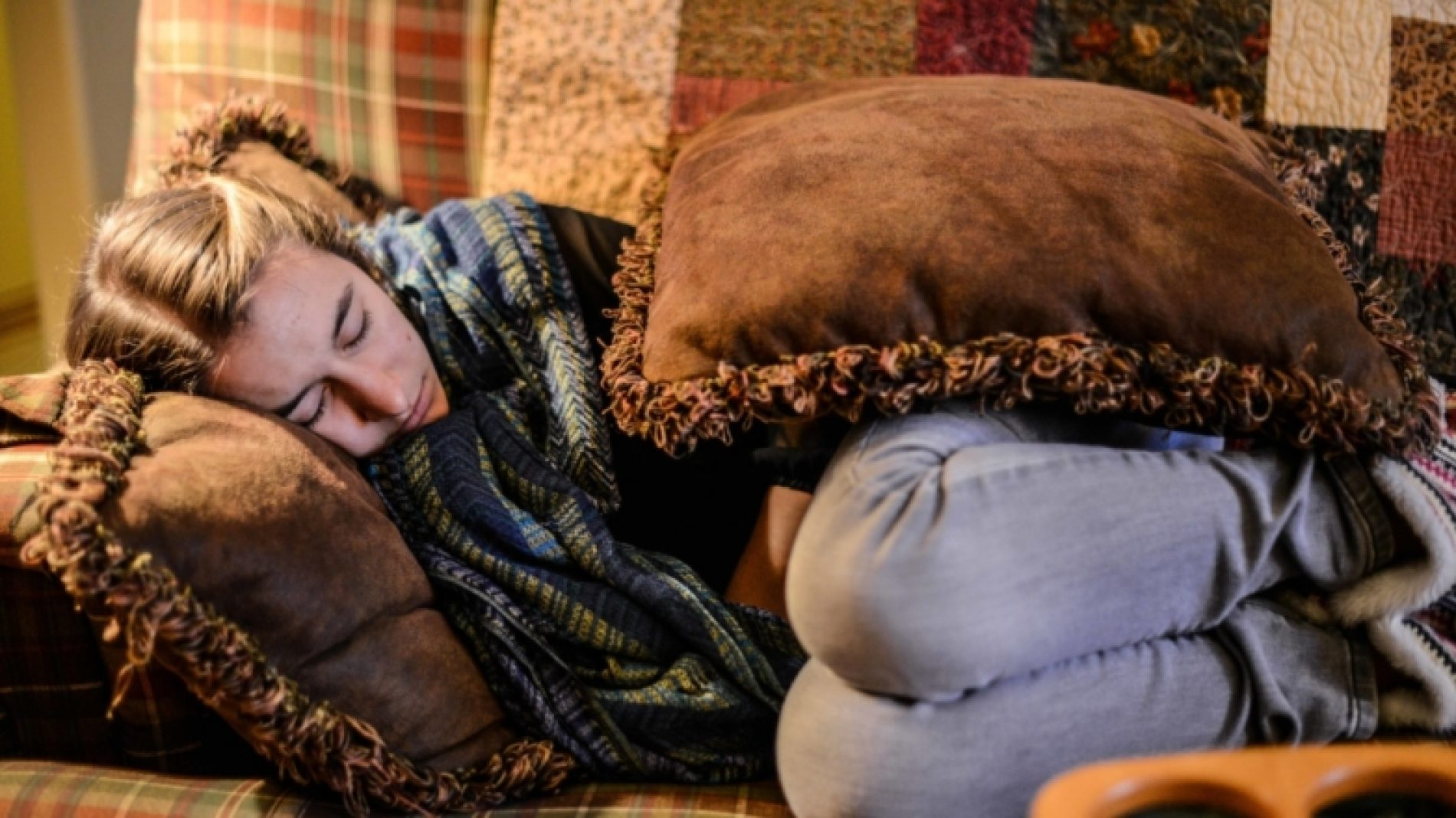 Young-person-sleeping-on-a-couch-7NEtHz