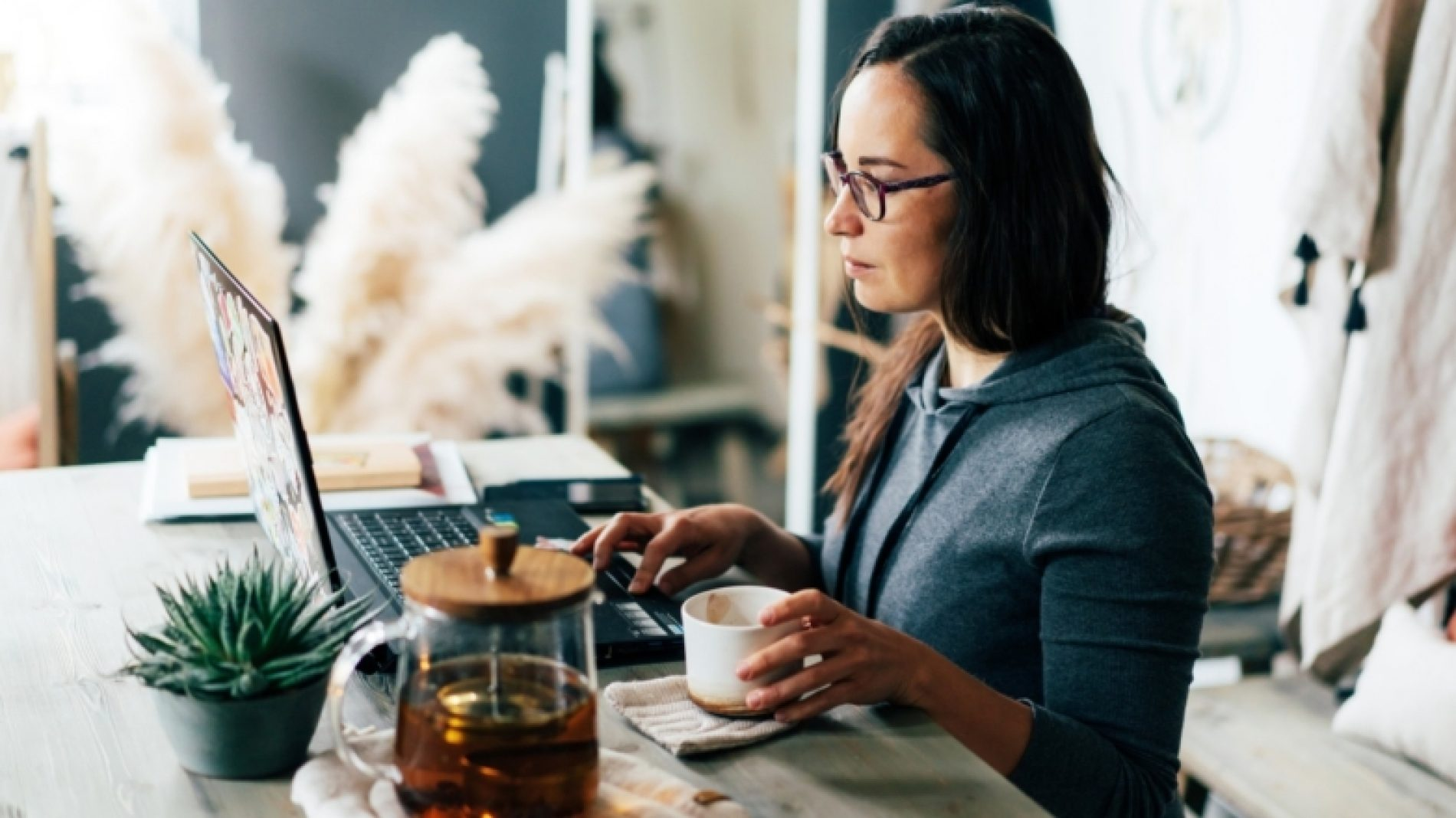 Young-person-studying-at-home-with-tea-U8tUa8