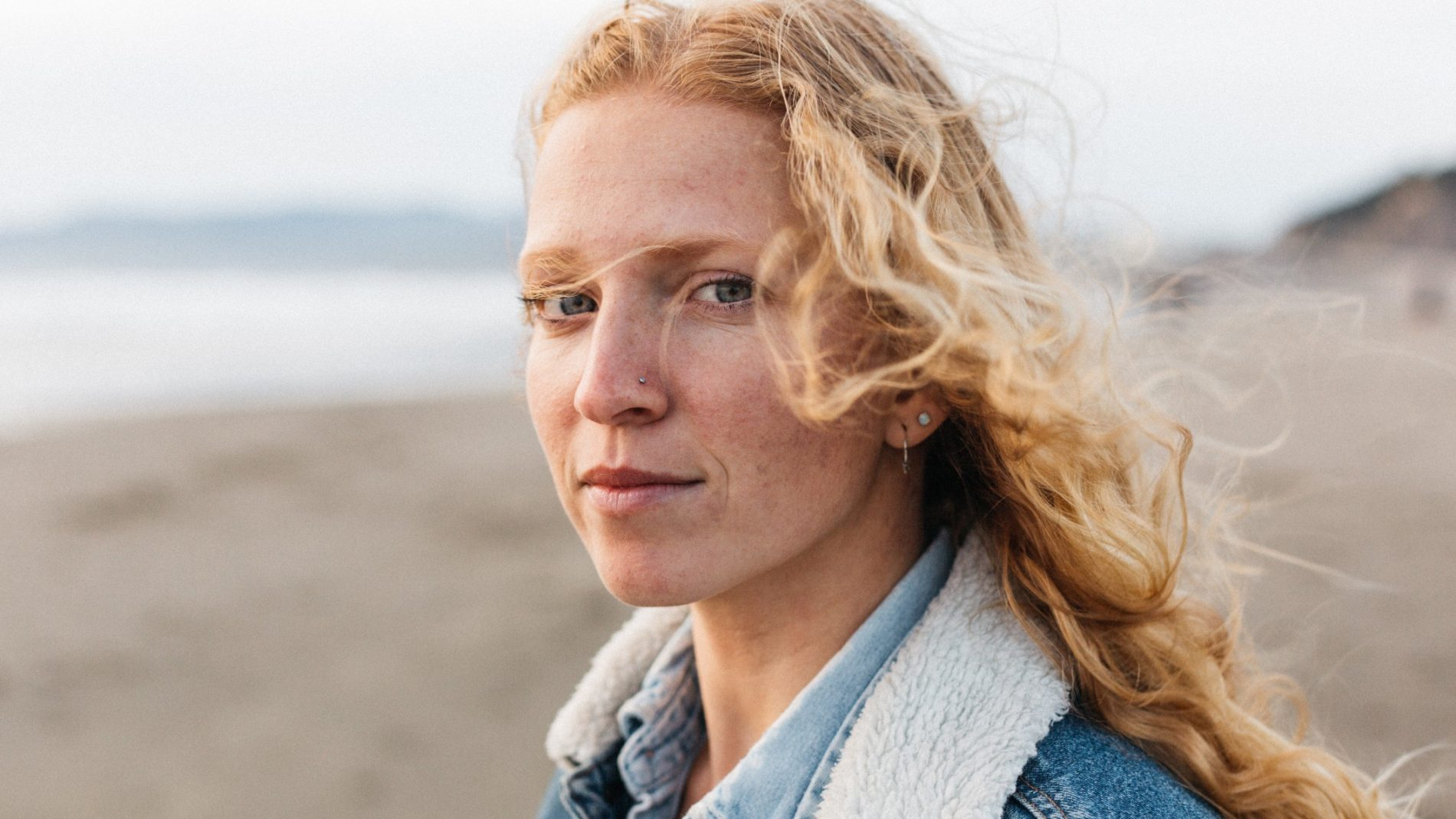 Young person with blond curly hair
