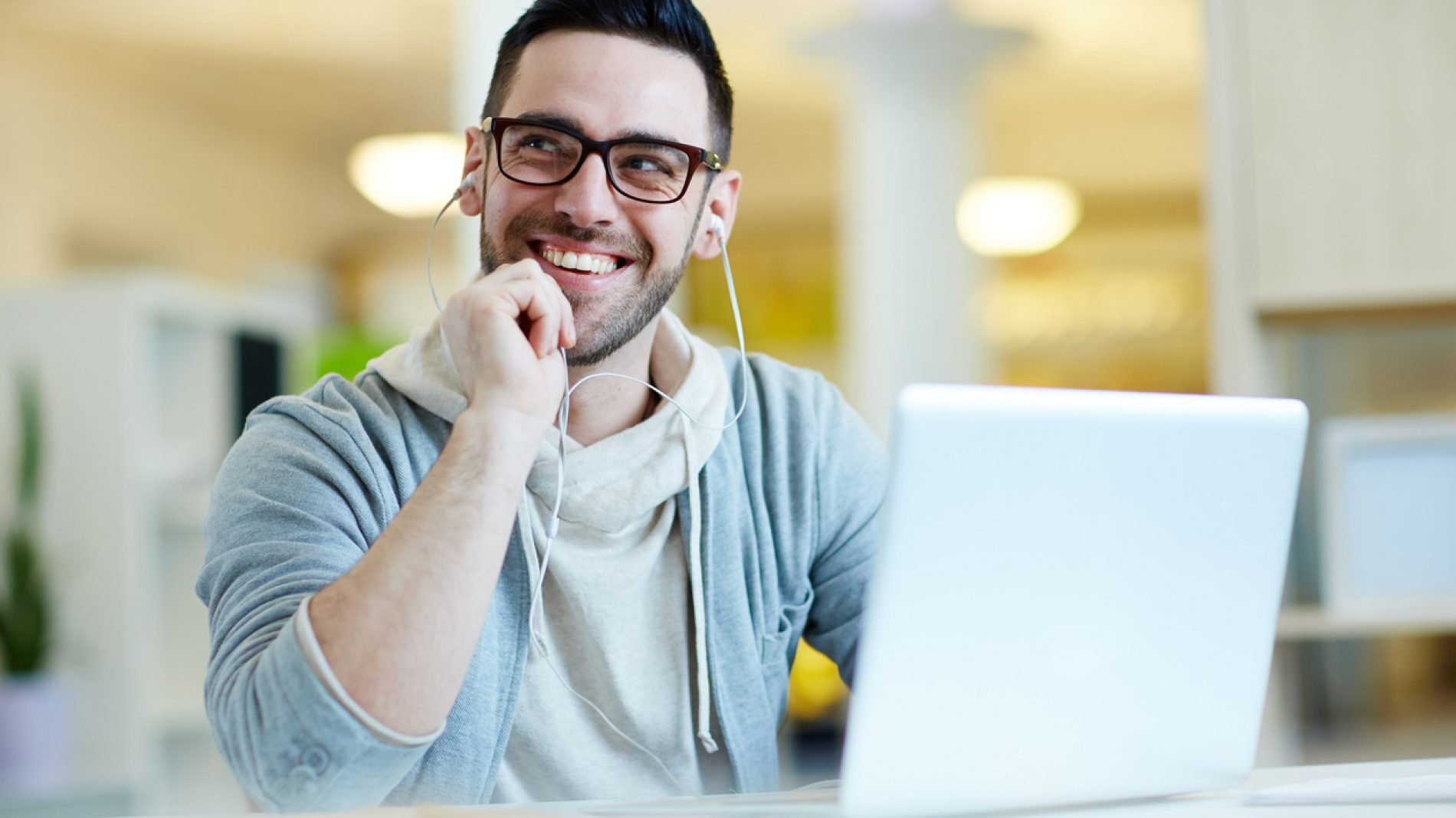 Smiling Adult Man Listening to Music