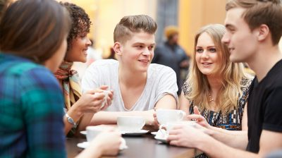 Group Of Young Friends Meeting In Café
