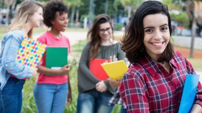 Hispanic female student with group of international students