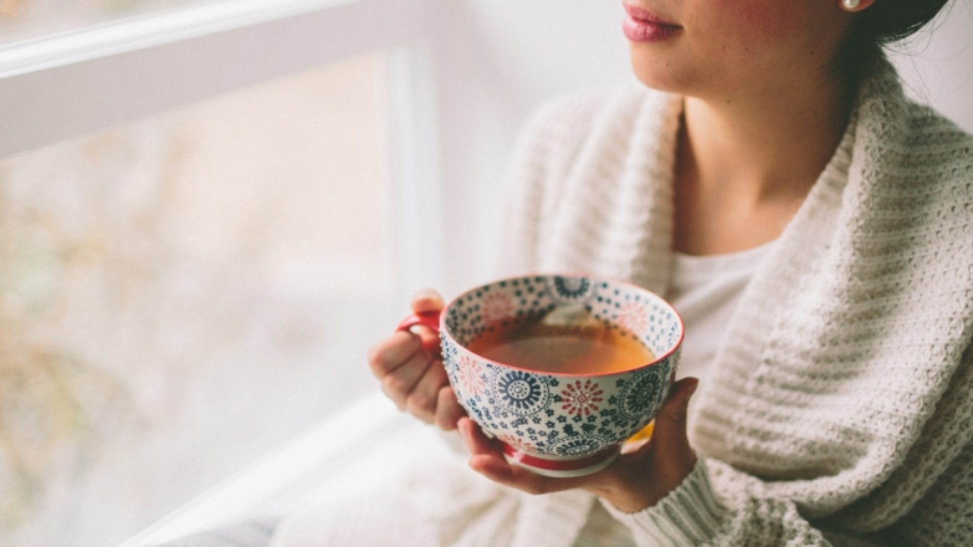 a-young-woman-drinking-tea-and-looking-out-the-window_t20_NG7N7p-Siv79T