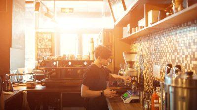 Barista at work in a coffee shop. Preparation service concept