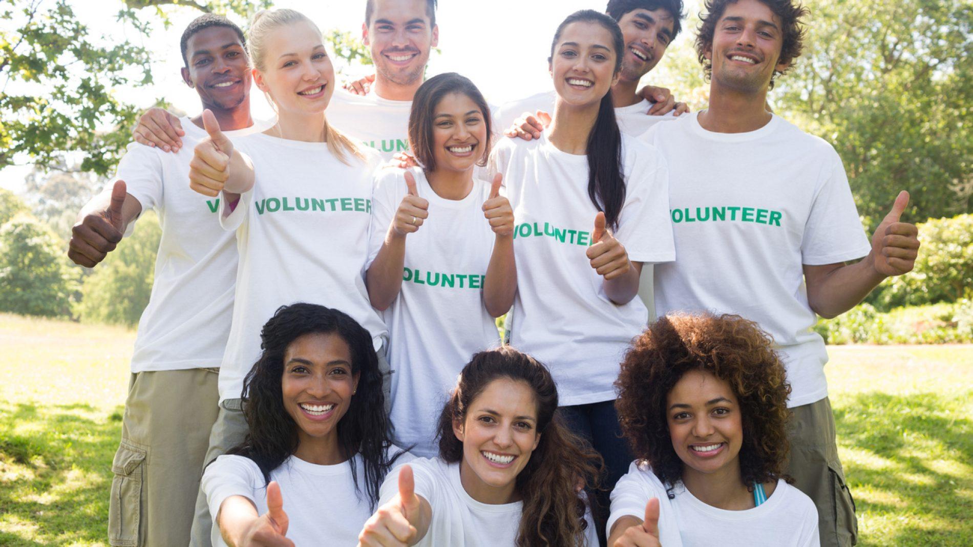 Volunteers gesturing thumbs up