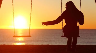 Young woman alone on the swings.