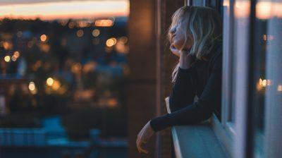 Woman thinking in window