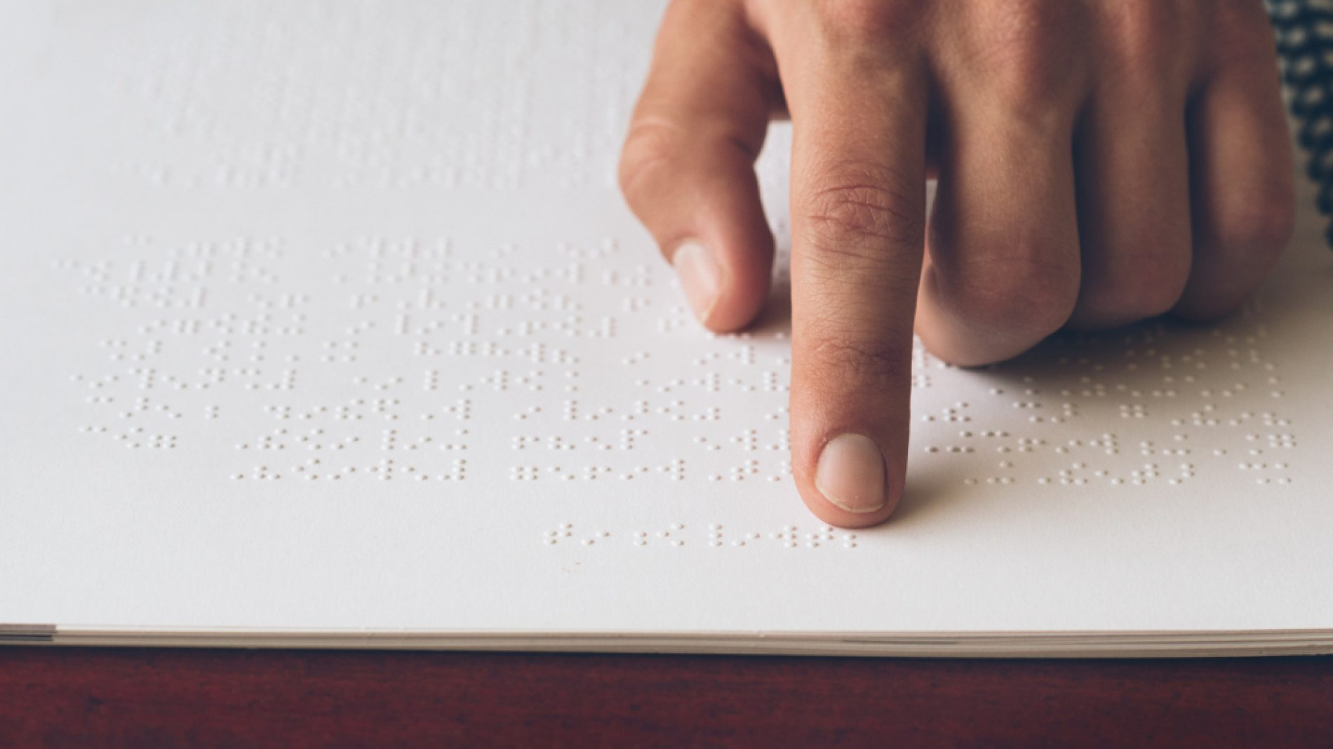a person reading braille