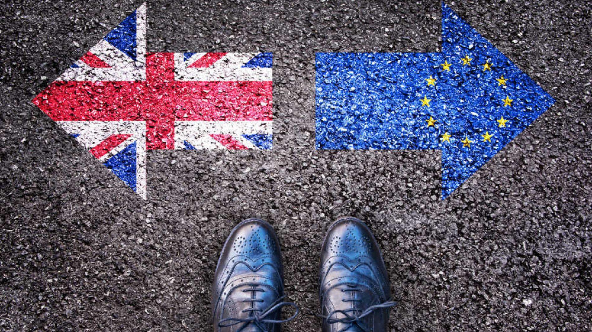 feet beside a uk flag and eu flag