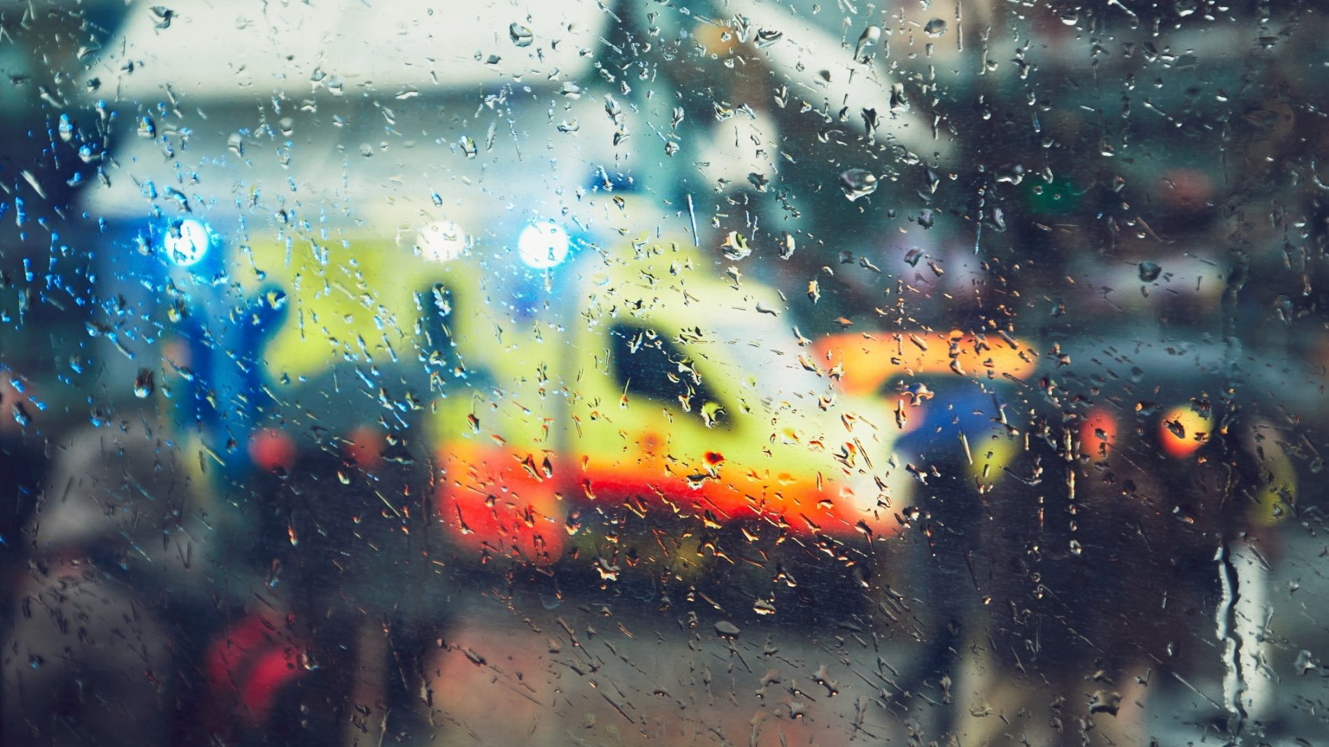 A photo of an ambulance through a rainy window