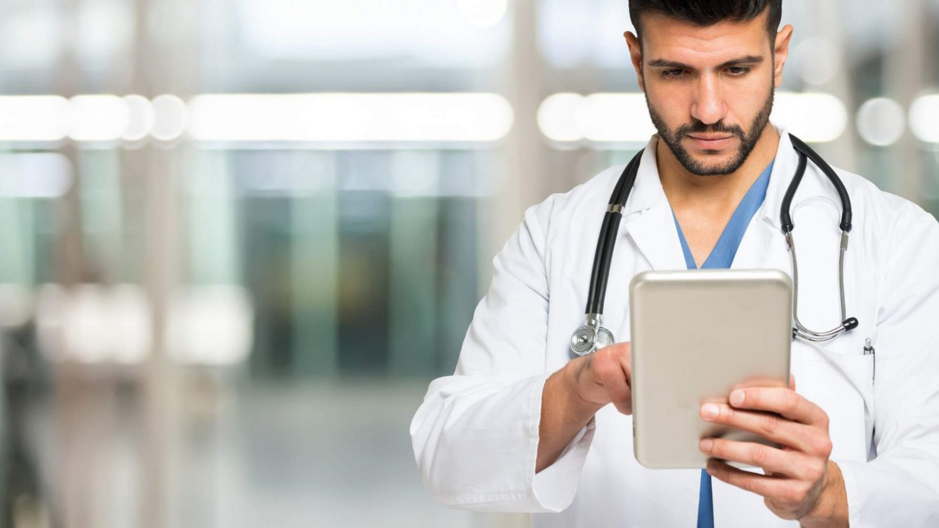 doctor on his tablet