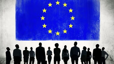 Image of the EU flag with silhouettes in front of it