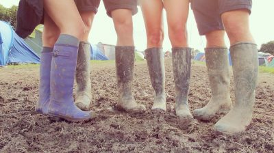 people wearing wellies at a festival