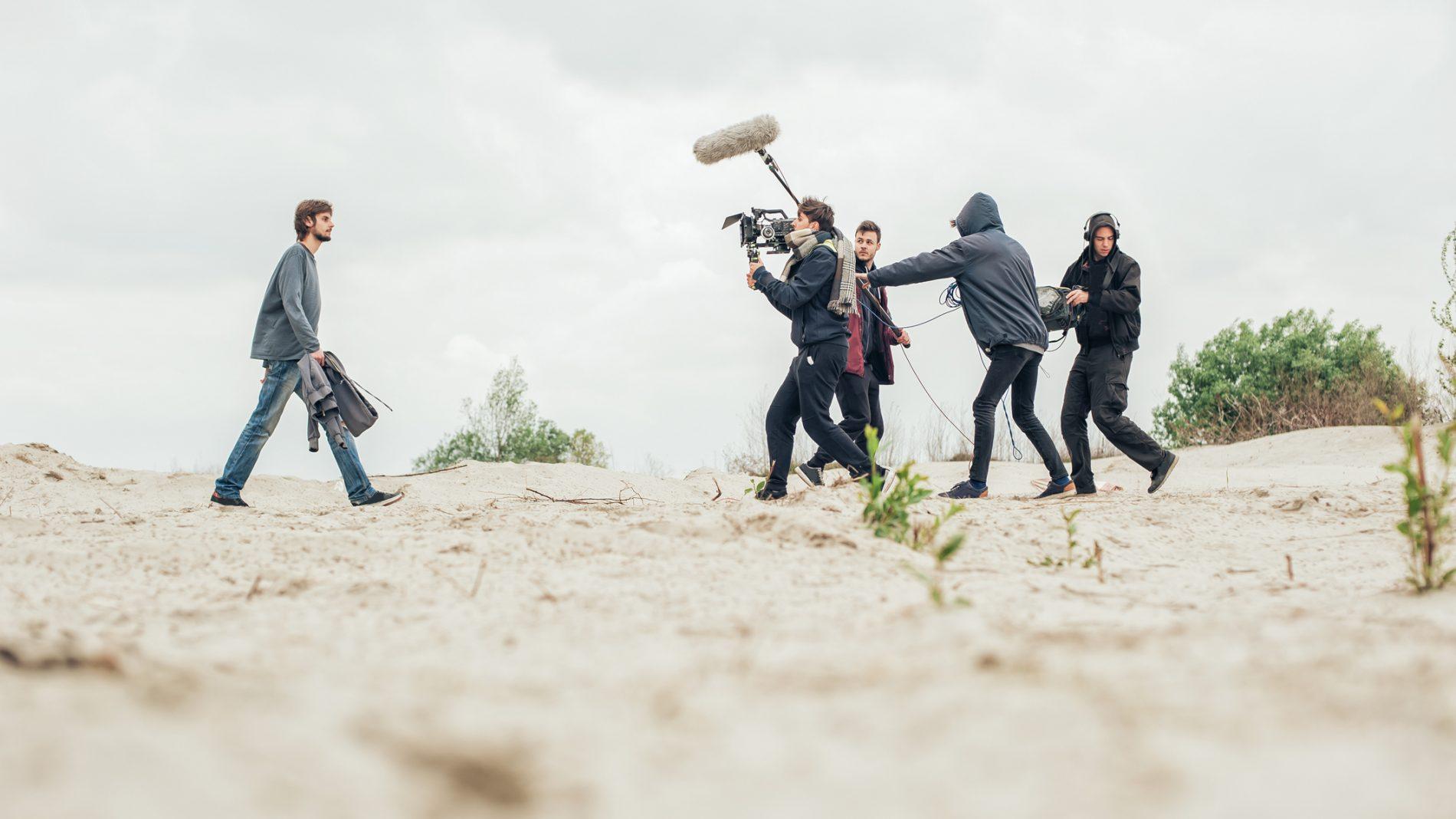 film crew on a beach