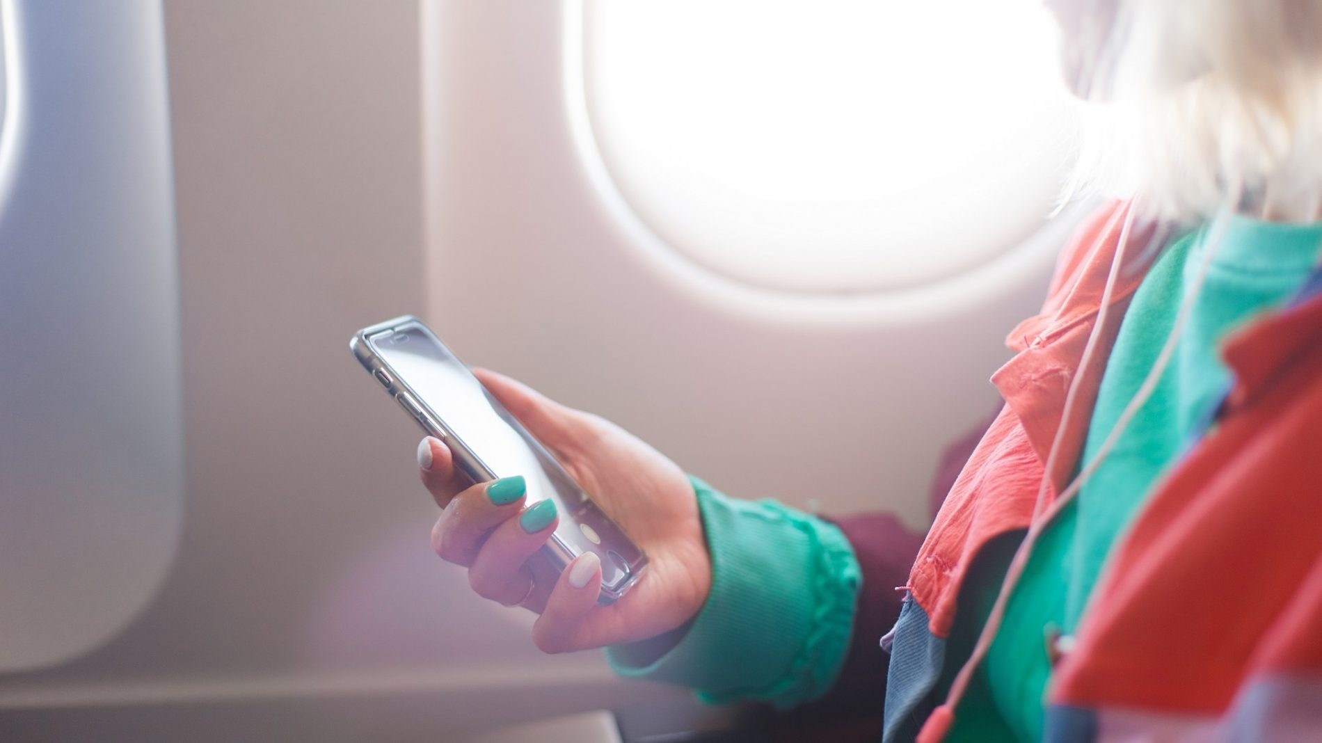 flying-airplane-music-airport-fly-mobile-phone-woman-business-woman-using-mobile-using-technology_t20_gox06Y