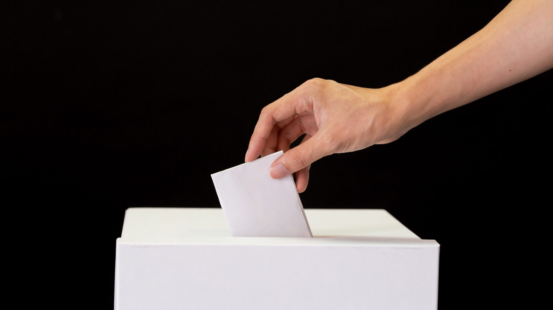 Placing vote in ballot box