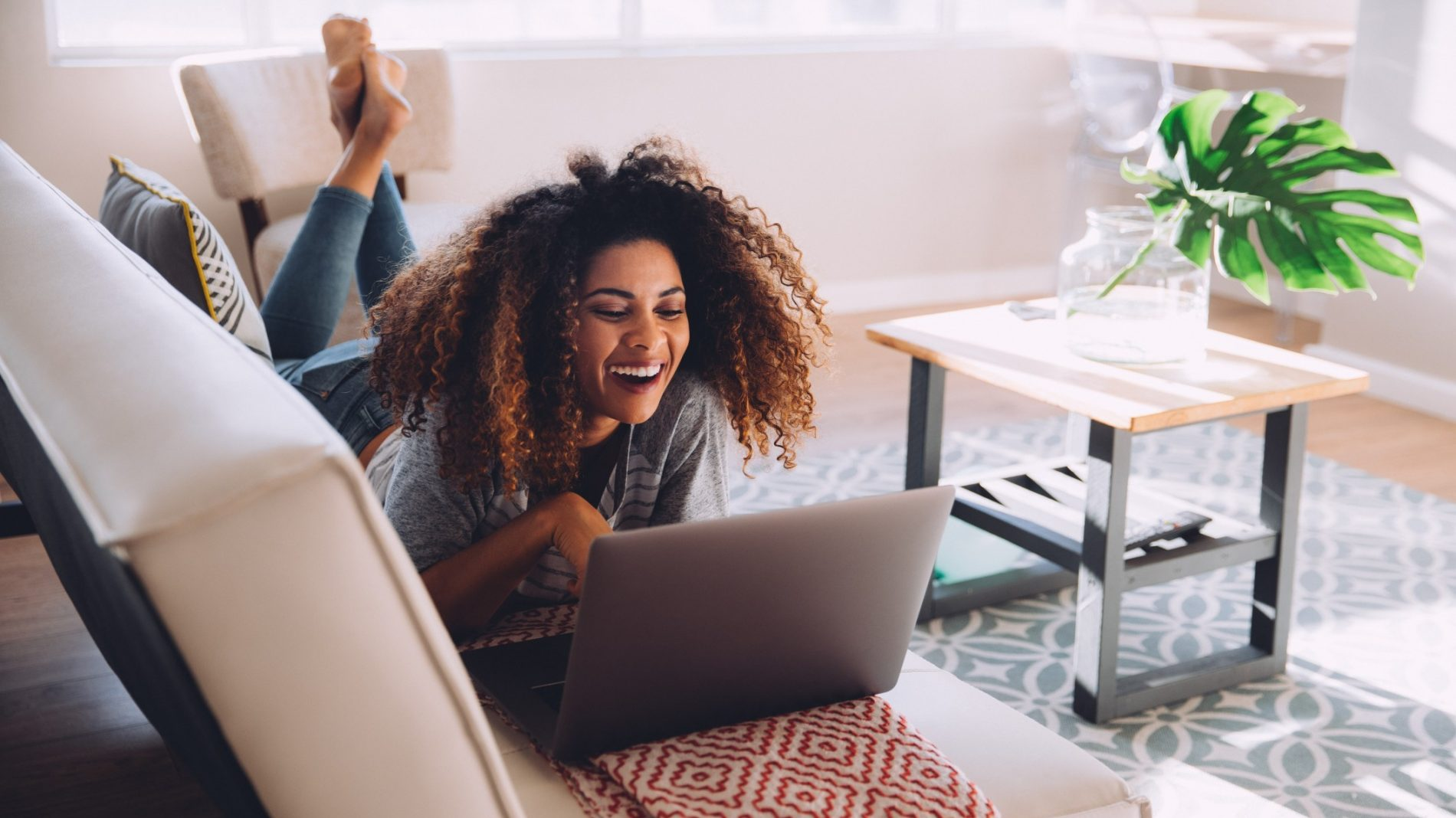 fun-home-woman-laptop-happy-laughing-afro-online-using-technology-video-chat_t20_Ggp9bw