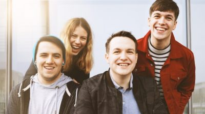 group-of-teenage-friends-laughing-together-q4JrZc