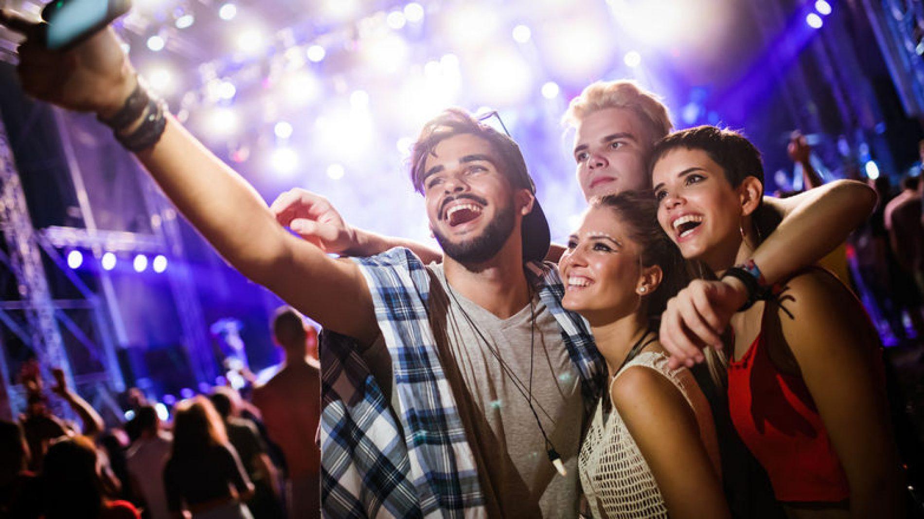 group-selfie-in-a-night-club