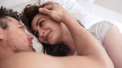 happy-couple-in-bed-contraceptive-implant
