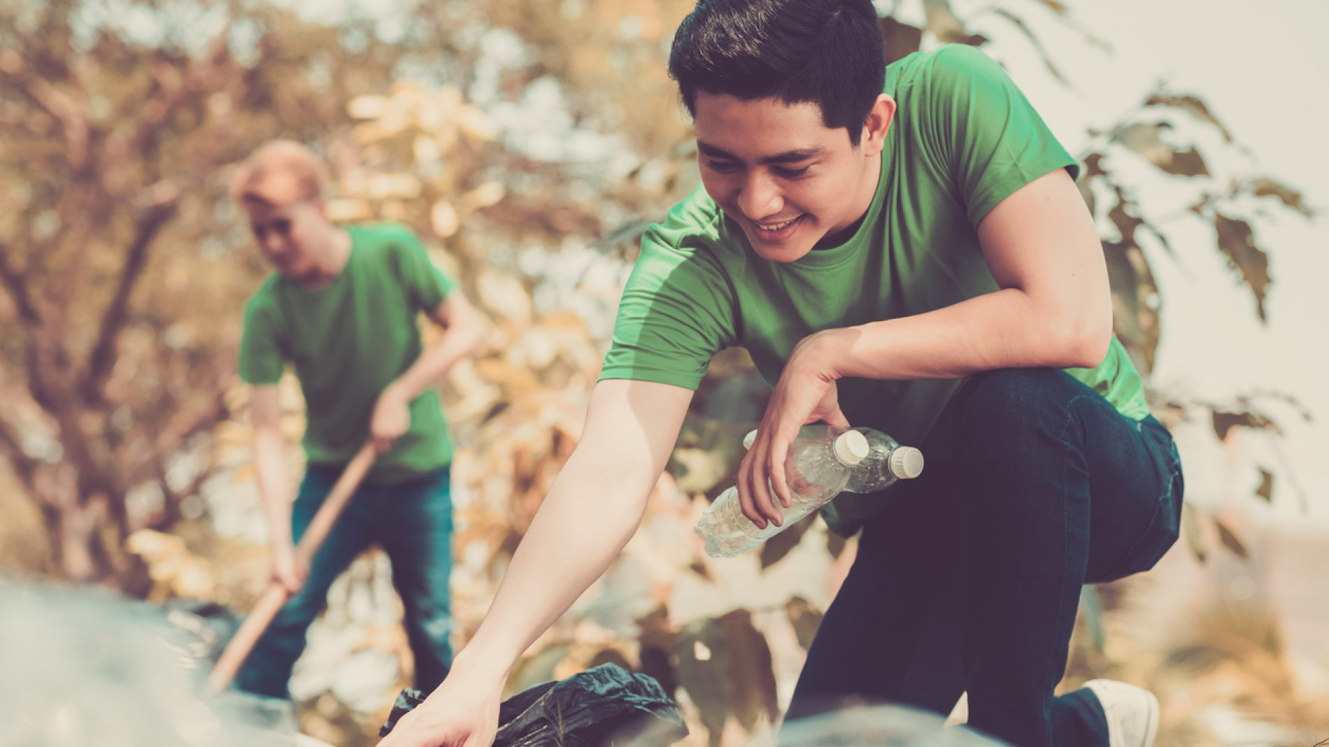 A young man picking up rubbish