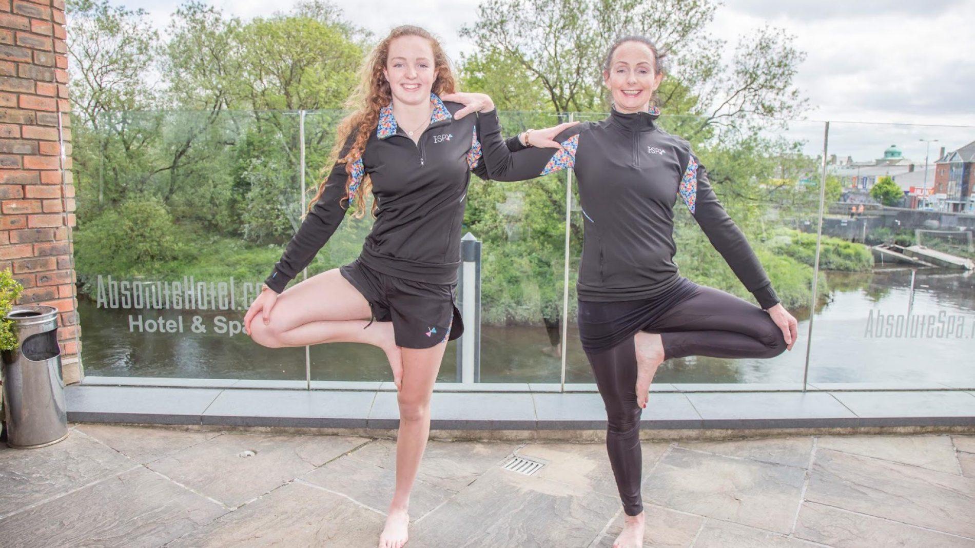 2 girls doing yoga