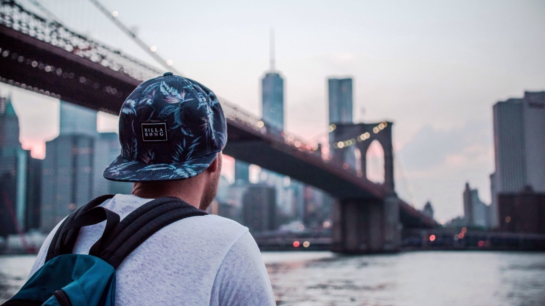 J1 student in new york looking at a bridge in Manhattan