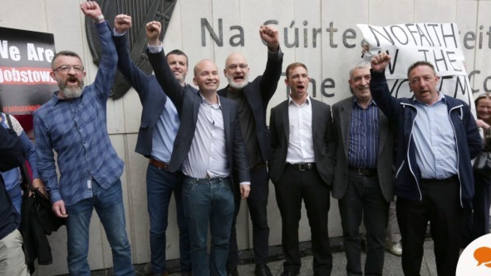 Six men from Jobstown trial raising their hands in the air after found not guilty