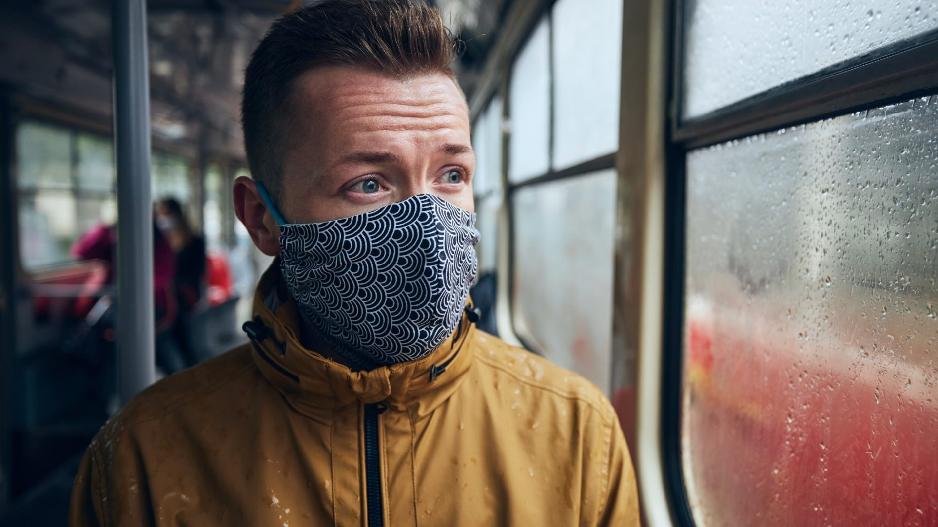 man-wearing-face-mask-in-public-transportation-themes-social-distancing-and-personal-protection_t20_e9NmLa