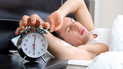 man-with-alarm-clock