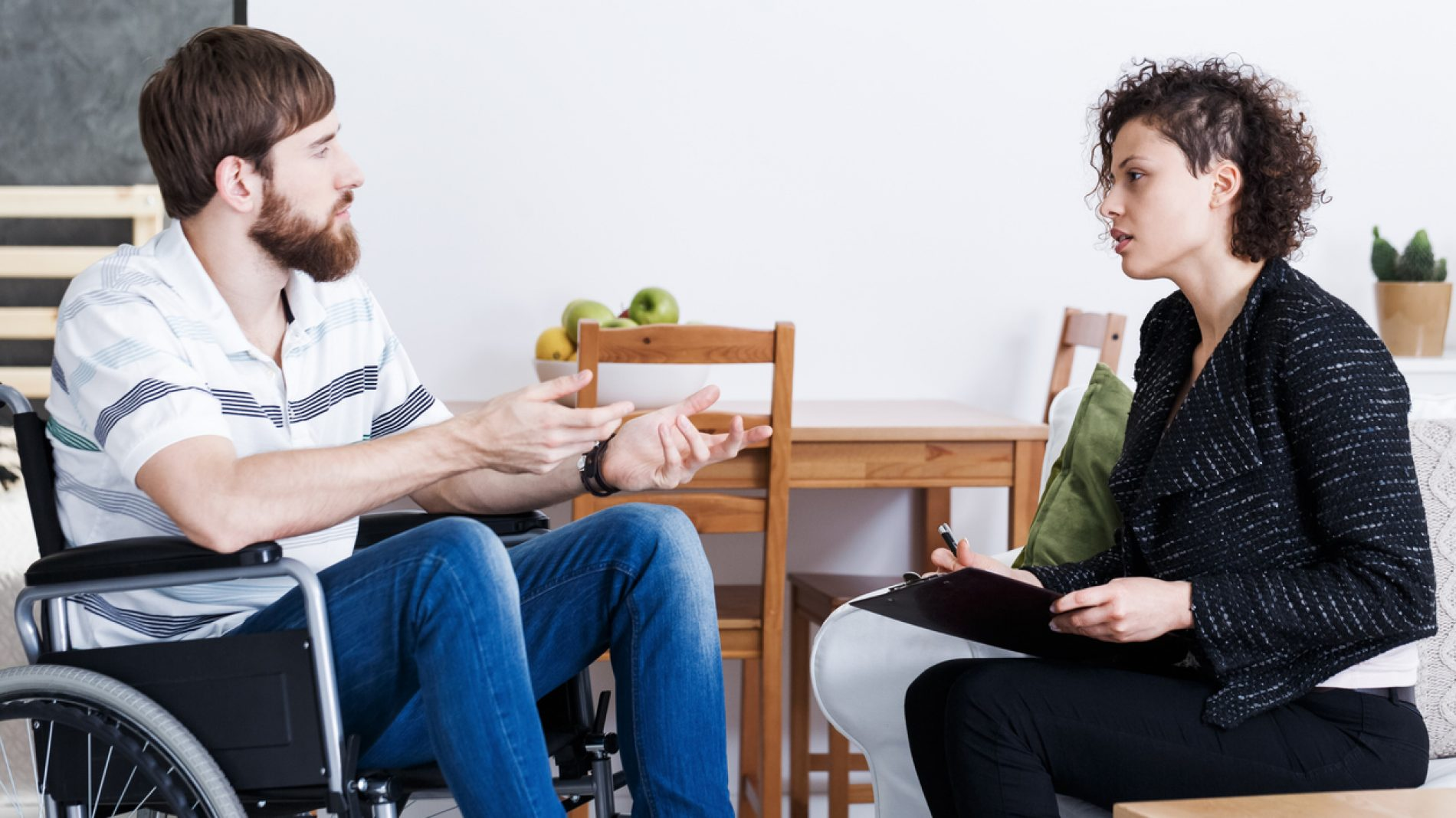 Young man talking with therapist
