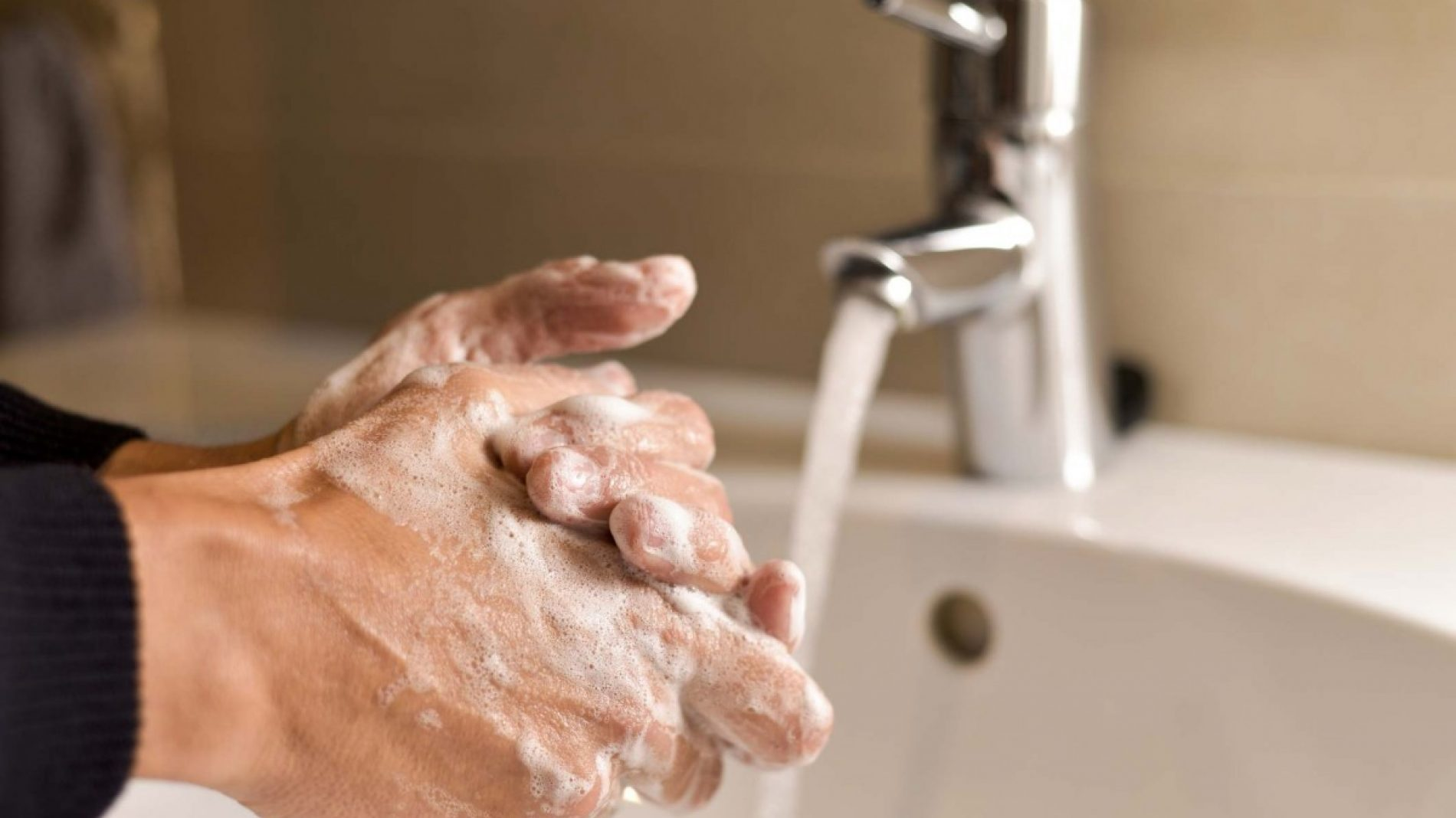 man washing his hands