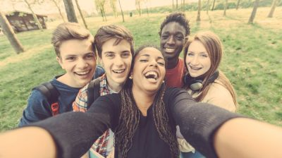 Group of young people taking a selfie