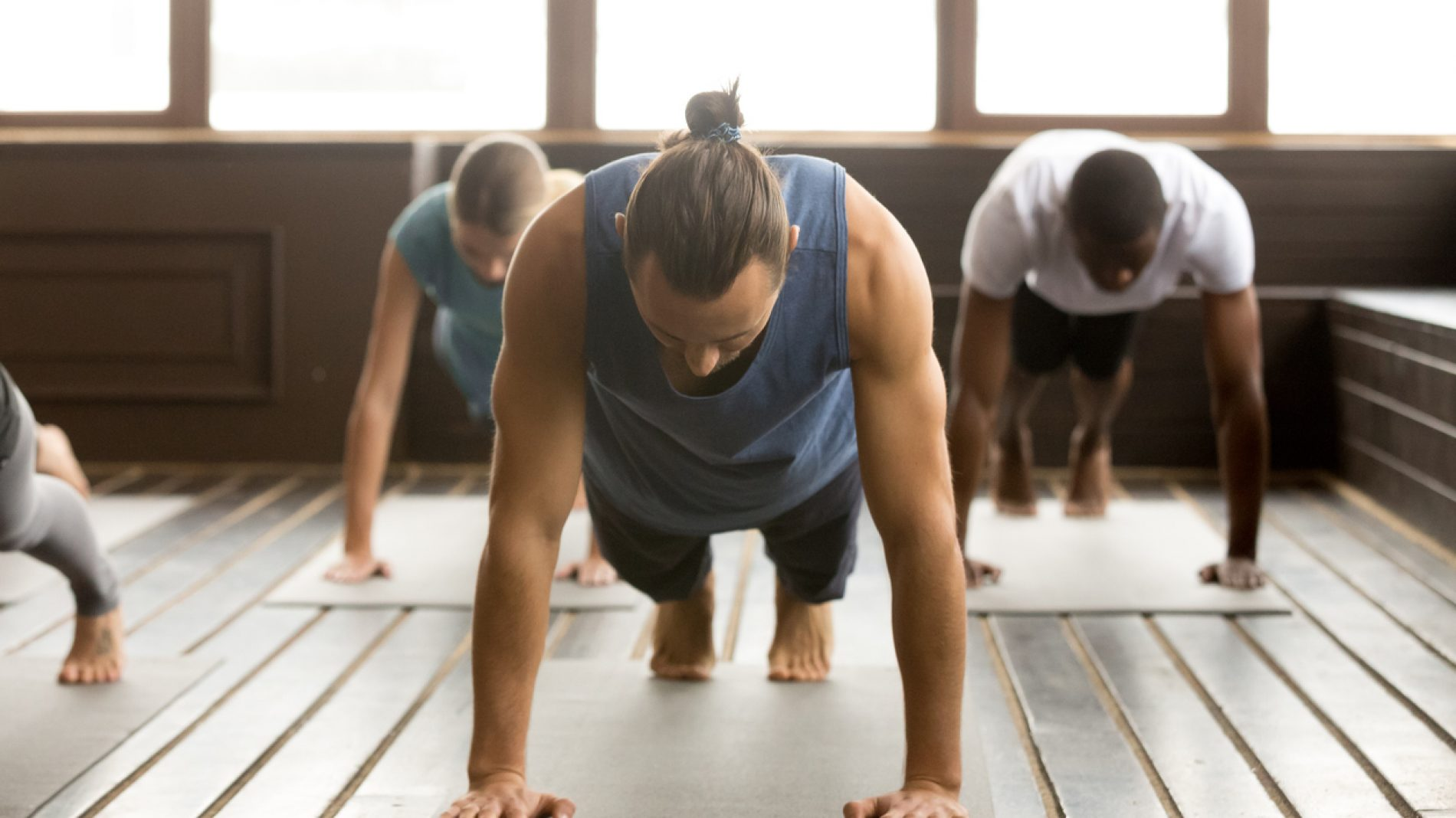 Group of sporty people in Plank pose