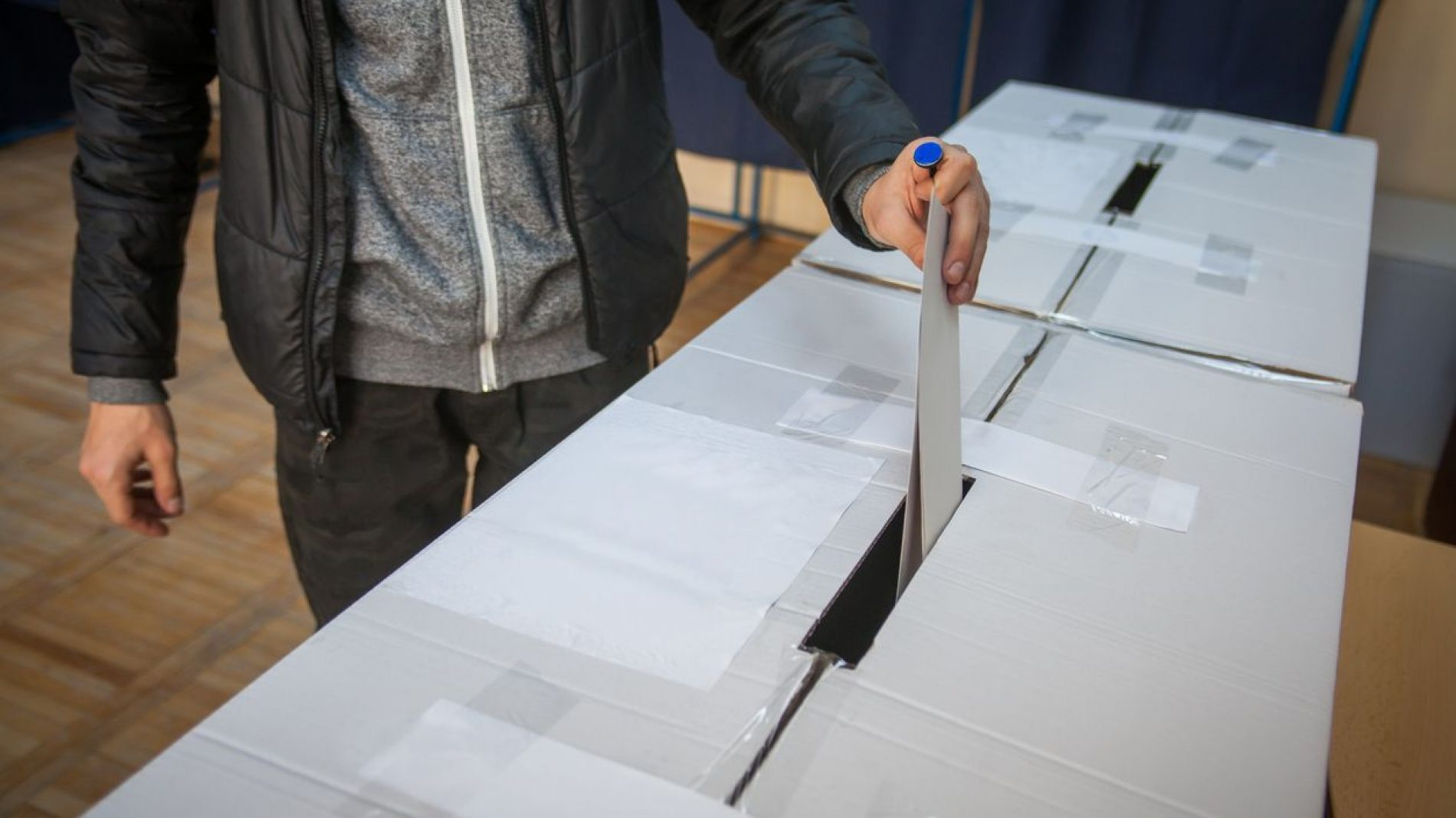 Placing a vote in a ballot box