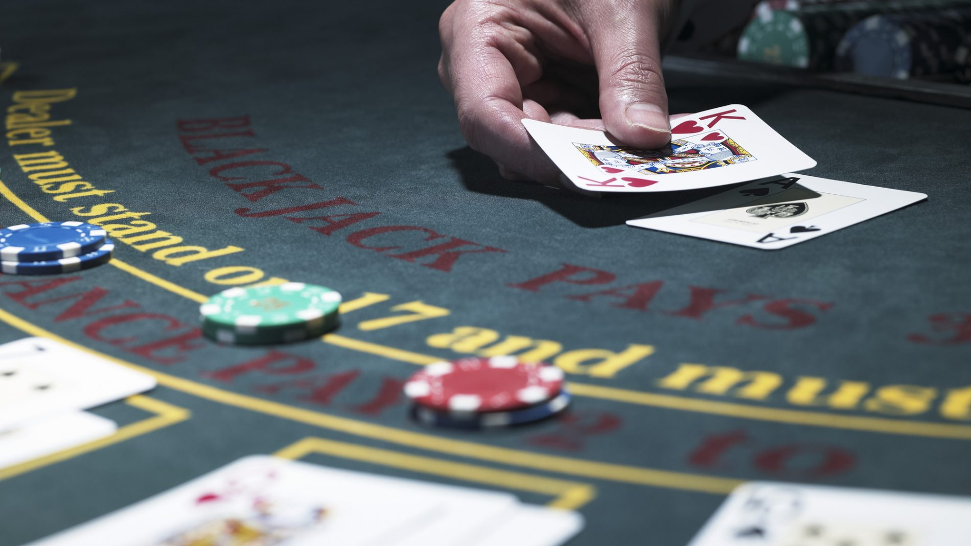 Man holding cards at blackjack table
