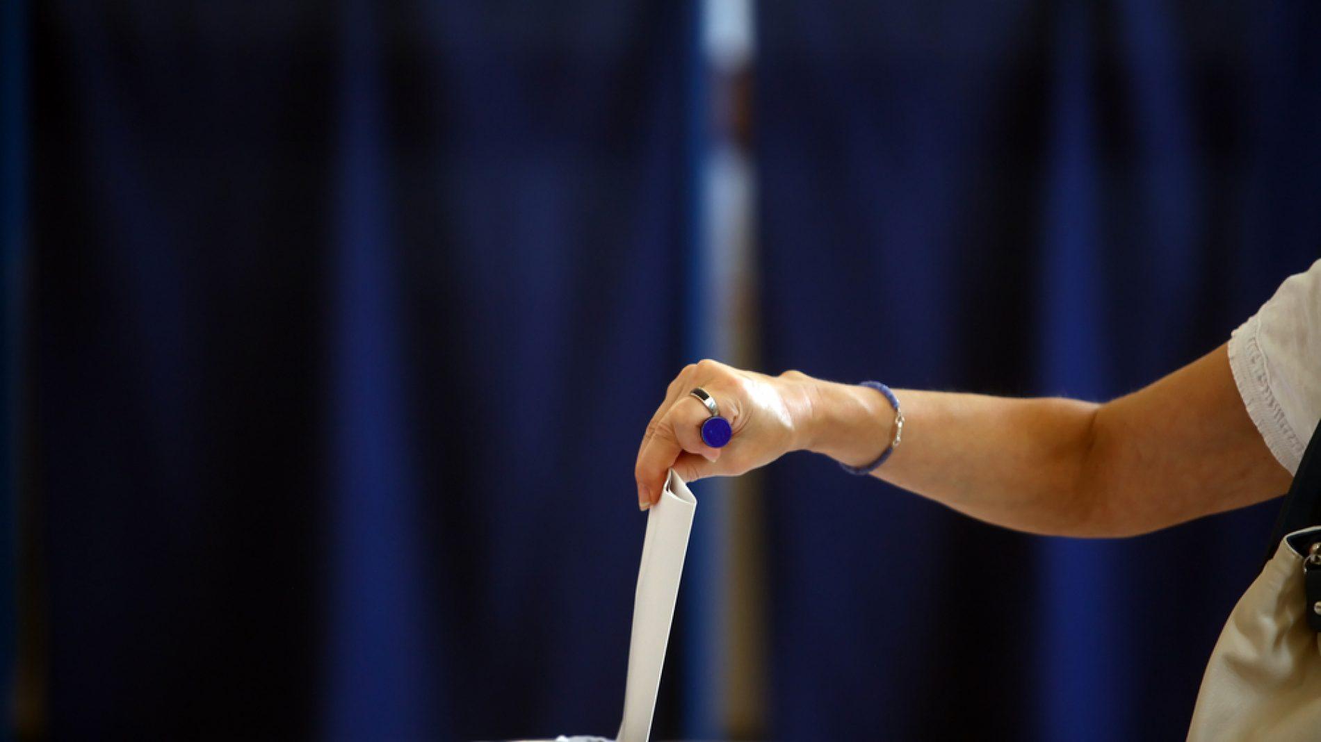 person casting their ballot