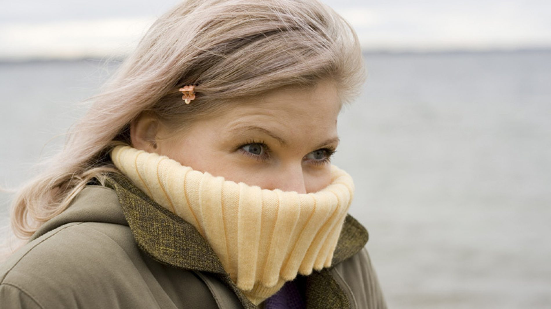 girl snuggled into her jumper