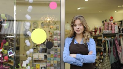 Young woman standing outside of a business