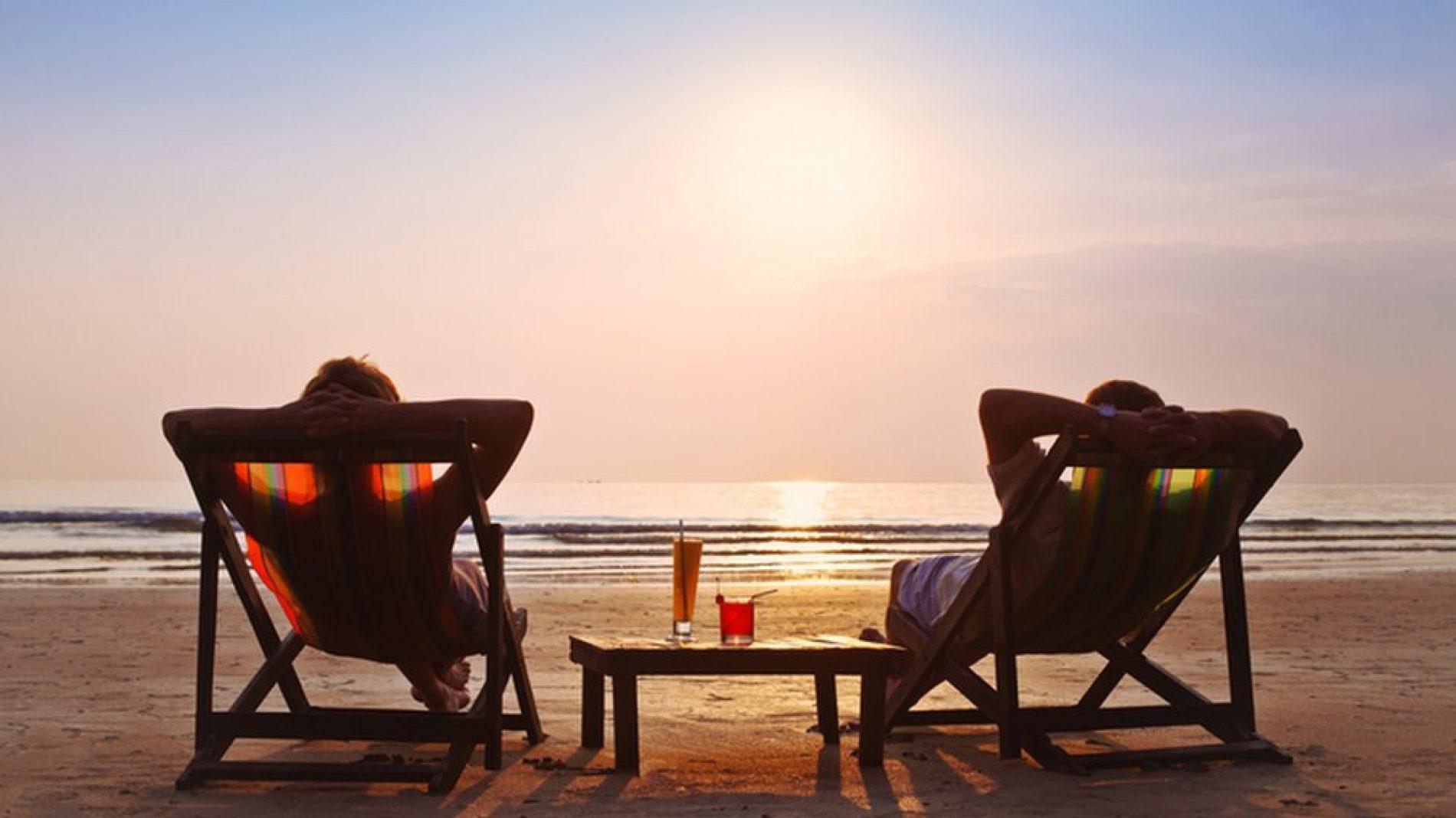 happy couple enjoy sunset on the beach