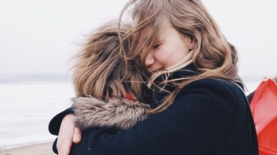 Two friends hugging