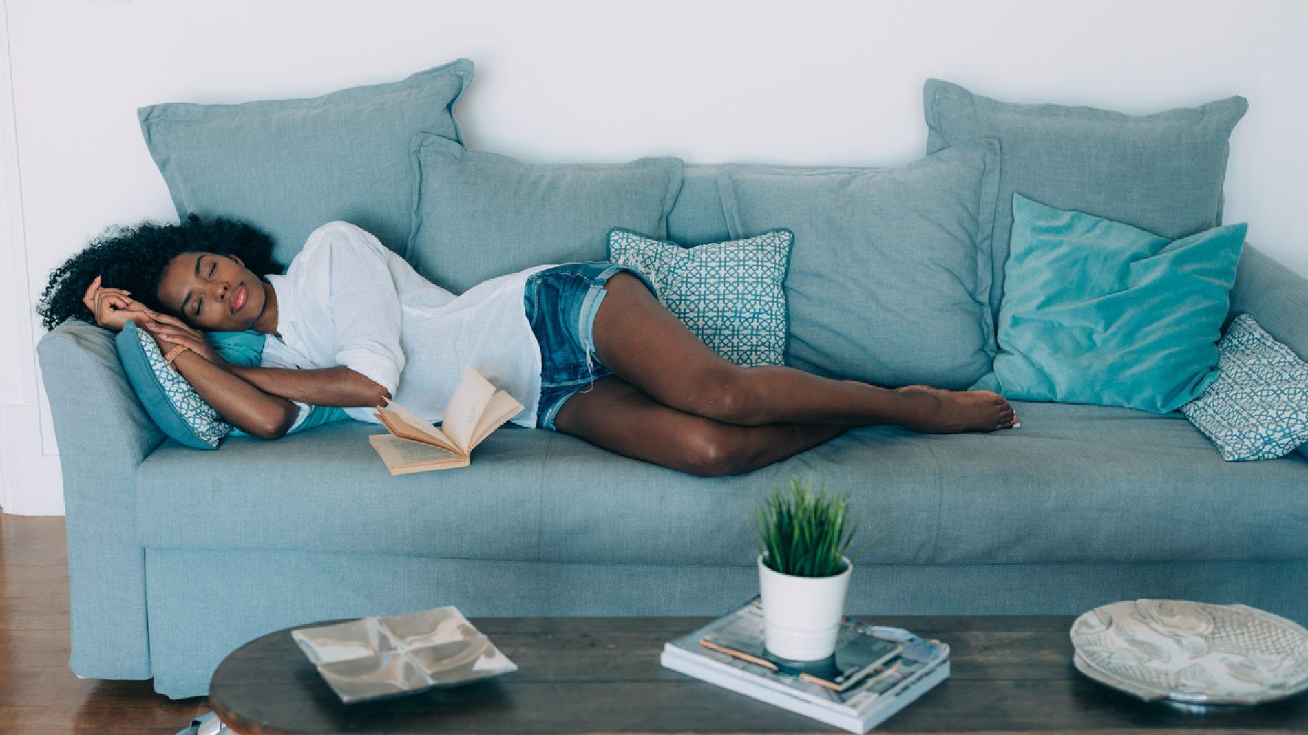 Beautiful black young woman sleeping in the sofa
