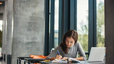 Asian student studying in library